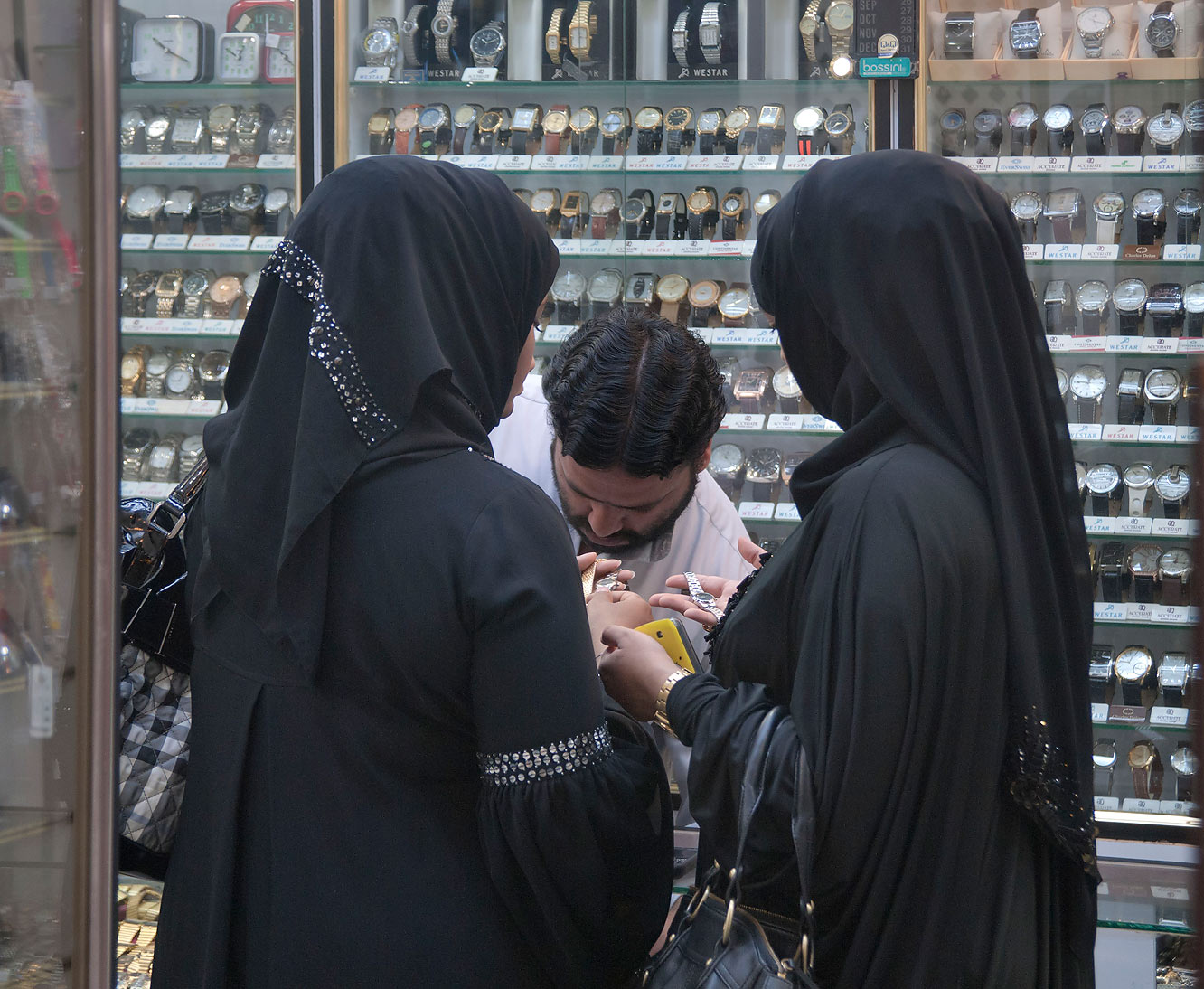 Women shopping for watches in Souq Waqif (Old Market). Doha, Qatar