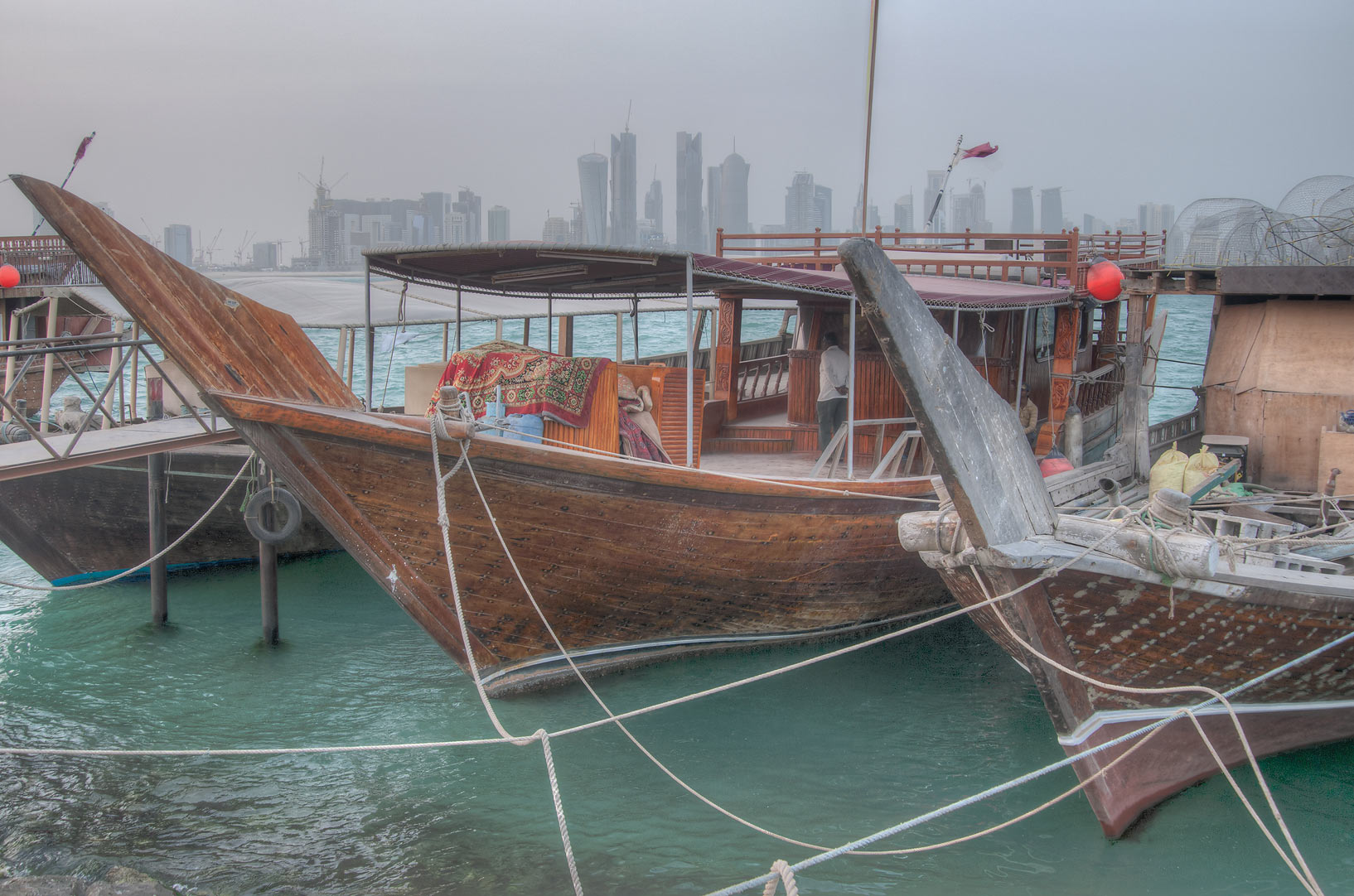 Dhow boats in fishing harbor, with West Bay in background. Doha, Qatar