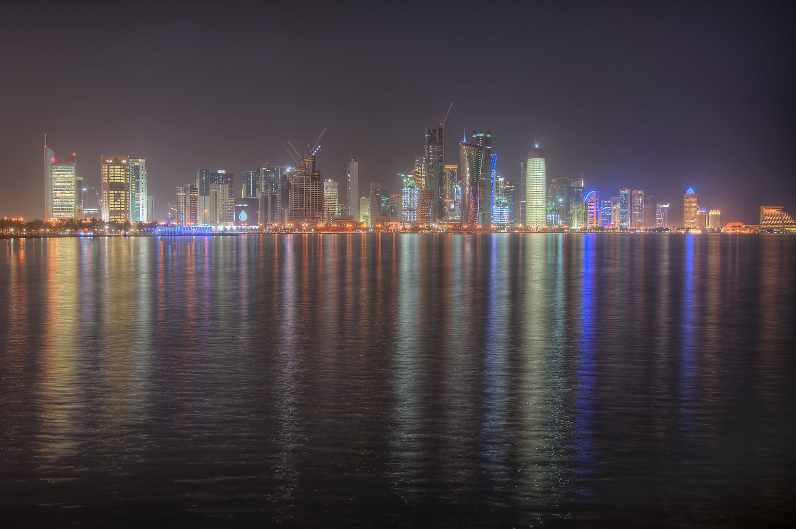 West Bay lights from Corniche at evening. Doha, Qatar