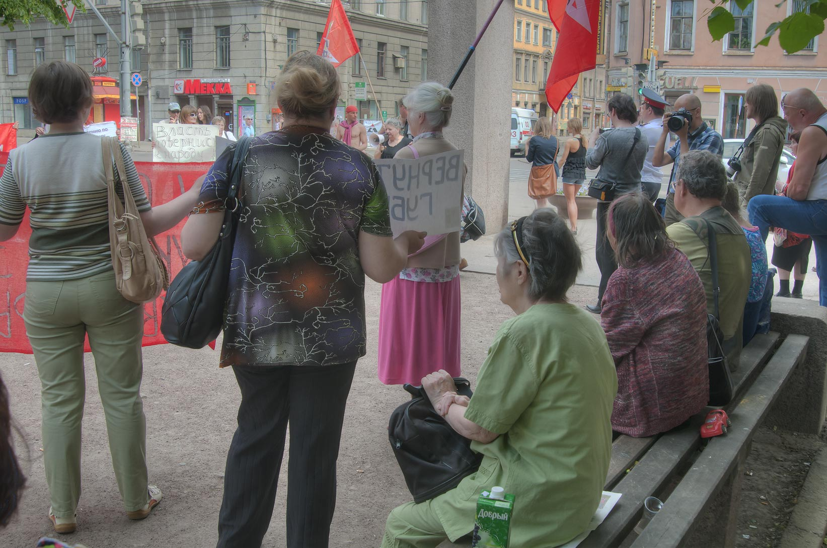 Pensioners watching Occupy Wall like political...V. Mayakovsky. St.Petersburg, Russia