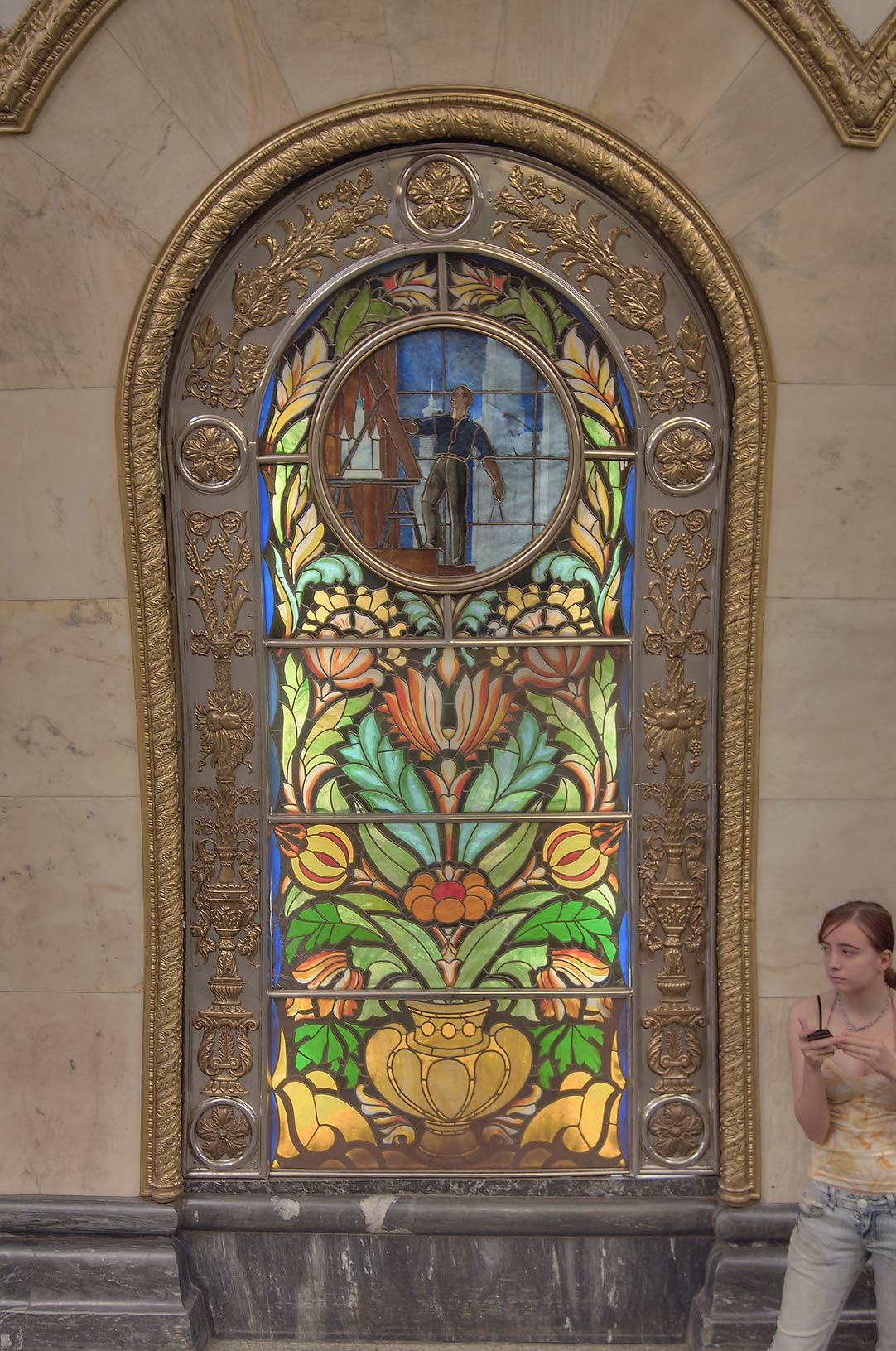 Stained glass panel in Novoslobodskaya Metro (subway) station. Moscow, Russia