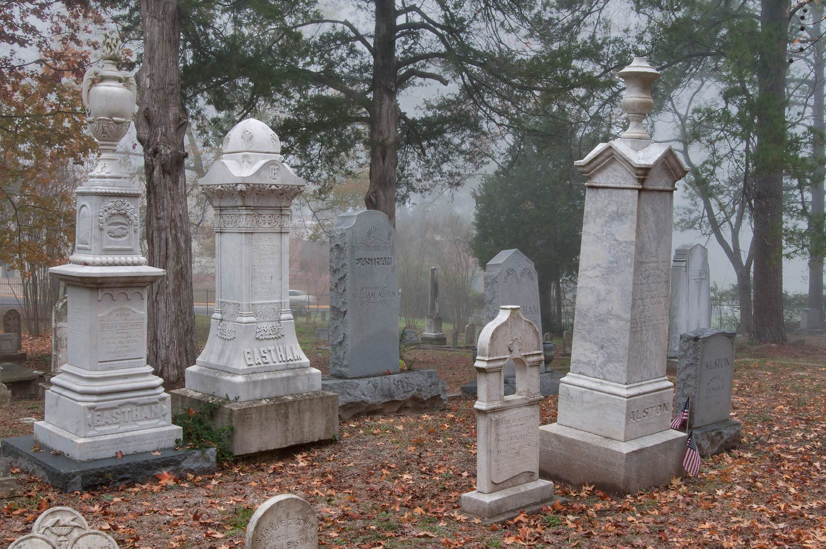 Marble tombs of Oakwood Cemetery in fog. Huntsville, Texas