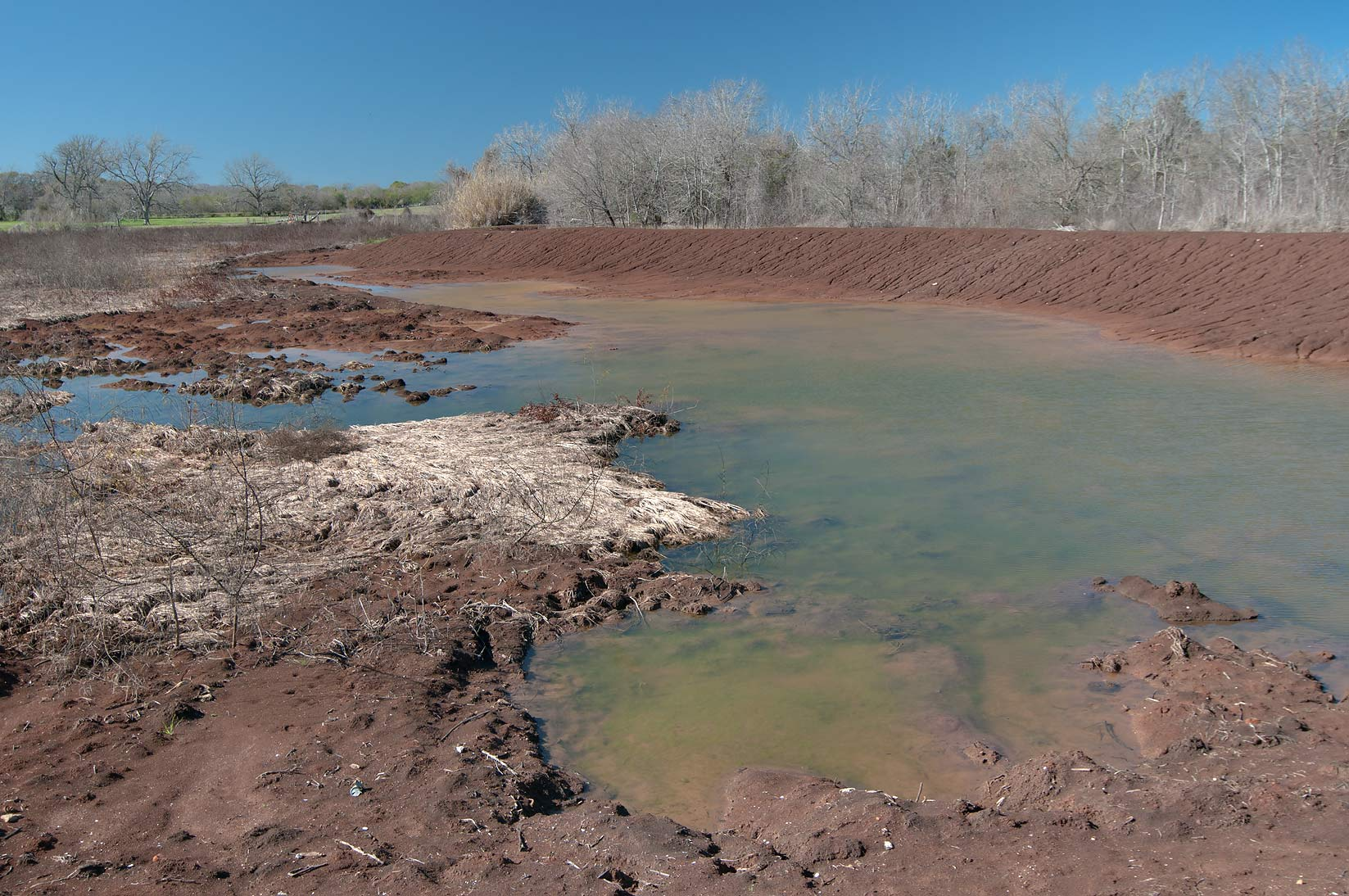 A pond filling by water after a draught in...State Historic Site. Washington, Texas