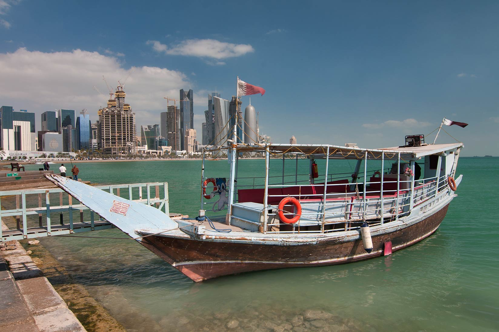 Dhow boat and West Bay, view from Corniche. Doha, Qatar