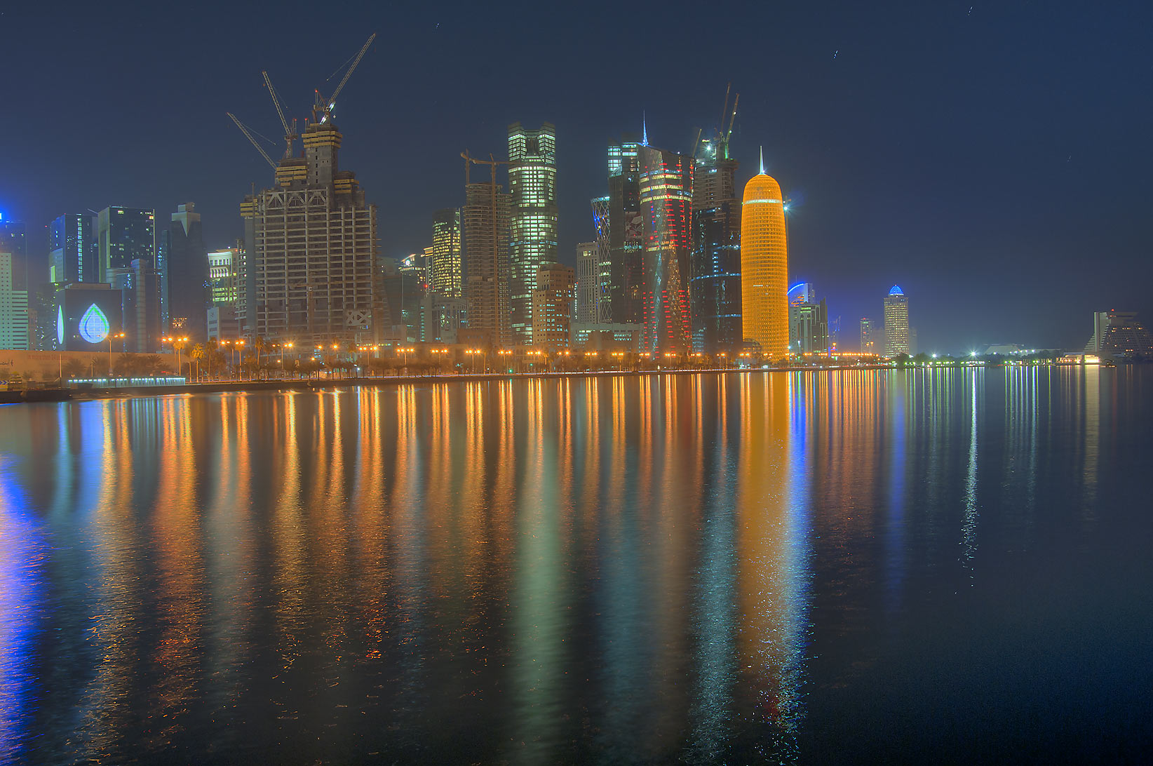 View of reflections of West Bay from Corniche at morning. Doha, Qatar