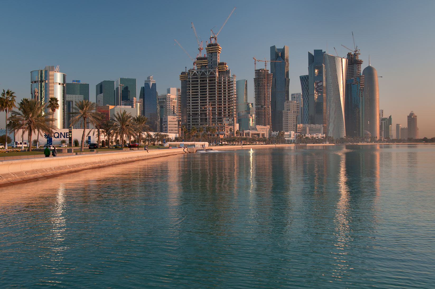 Corniche and West Bay, view from area near Balhambar Restaurant after sunrise. Doha, Qatar