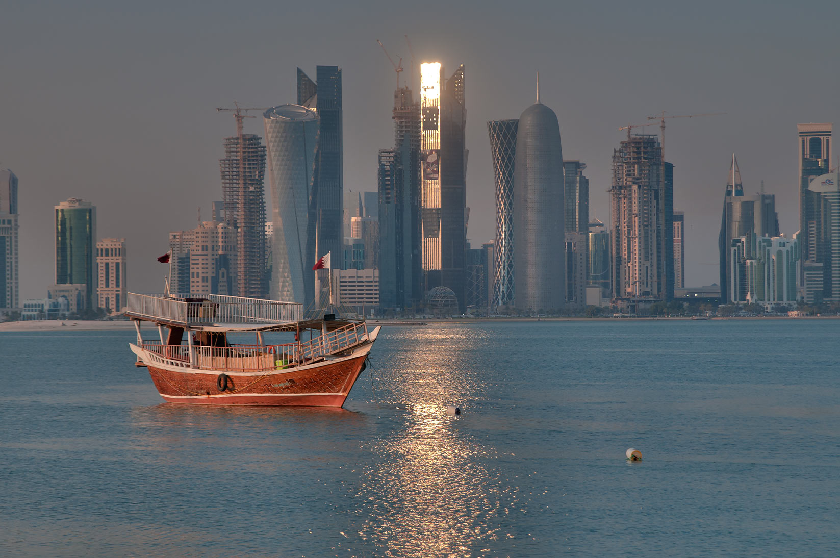 Dhow boat and West Bay, view from Corniche near Corniche Round About. Doha, Qatar