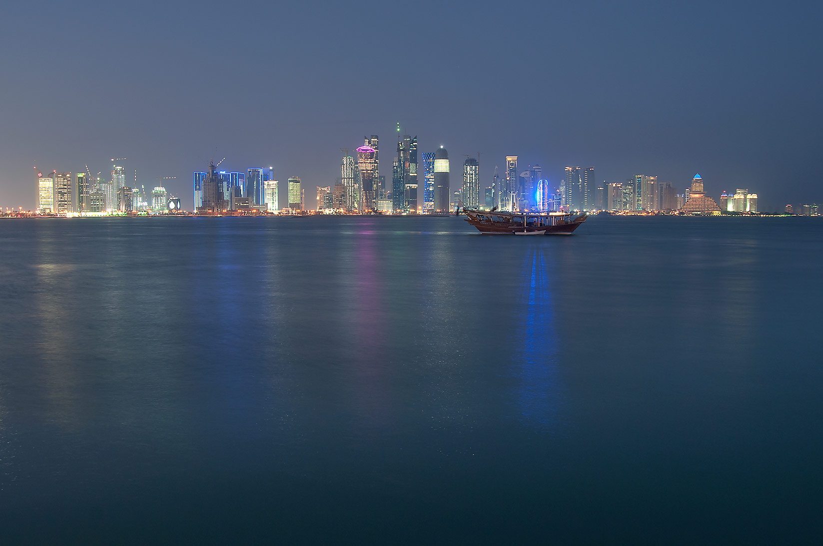 View of West Bay from a pier near Corniche at evening dusk. Doha, Qatar