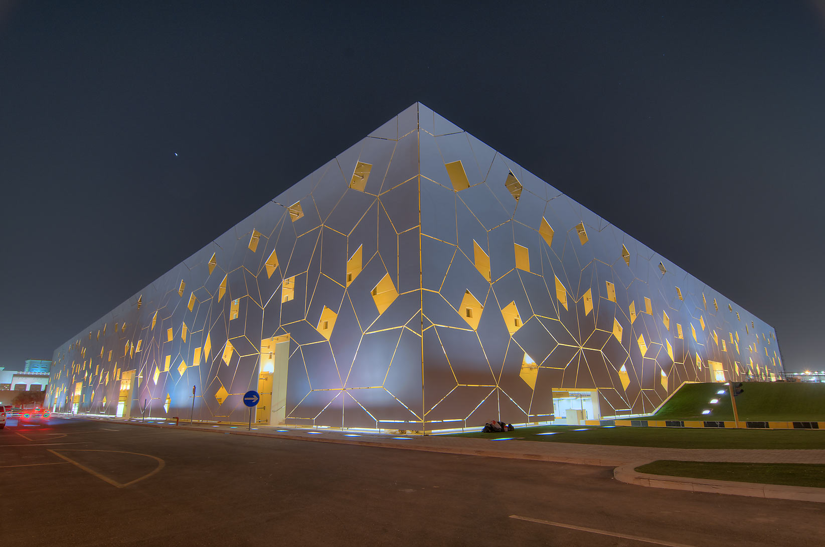 Penrose geometry of facade of Liberal Arts and...City campus at evening. Doha, Qatar