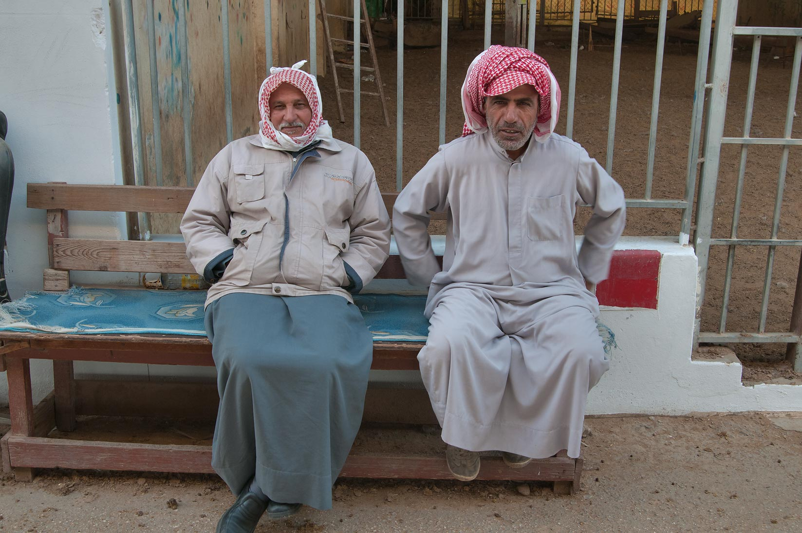 Two persons sitting in Wholesale Animal Market. Doha, Qatar