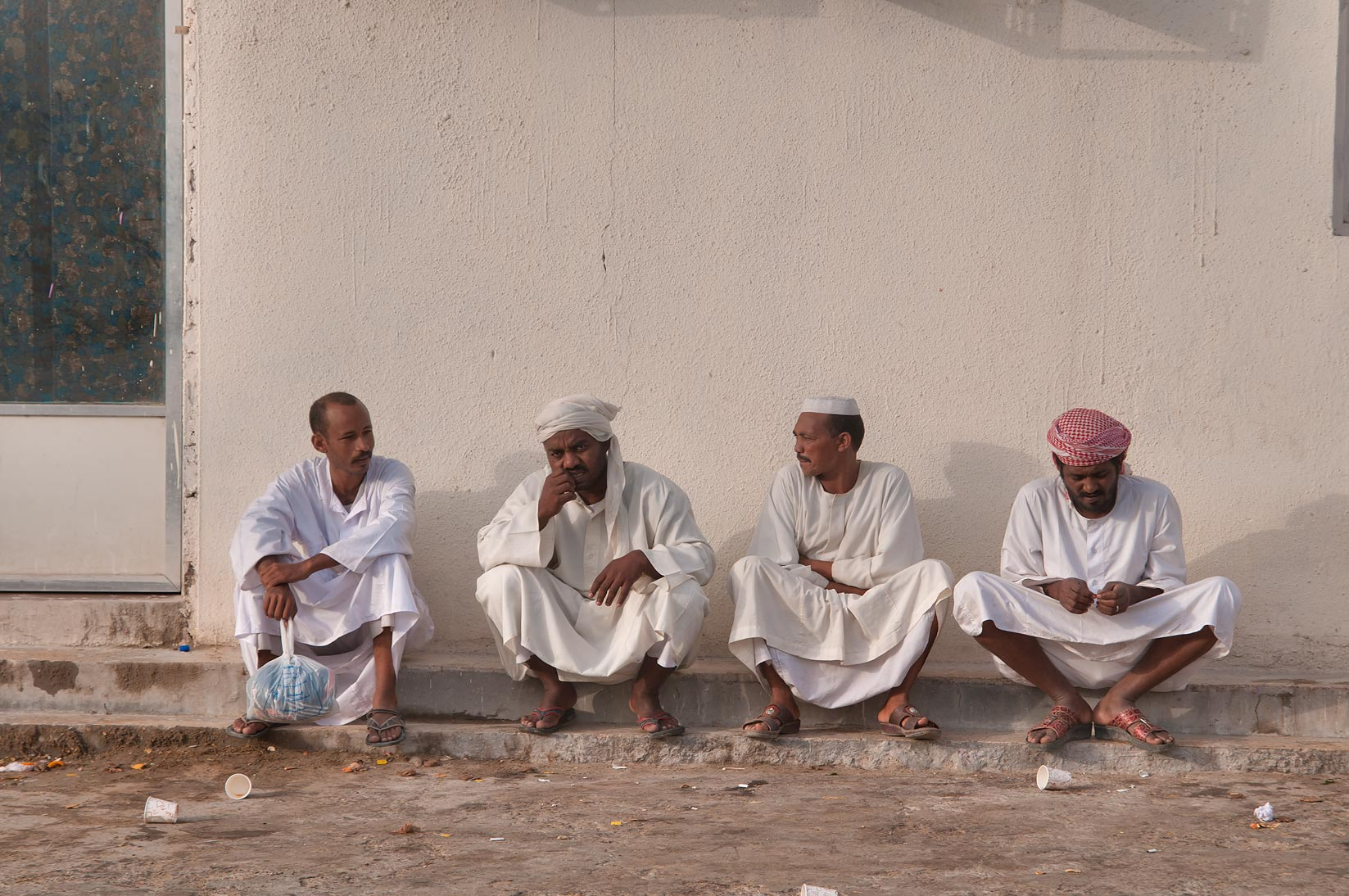 Group of sitting people in Wholesale Animal Market. Doha, Qatar