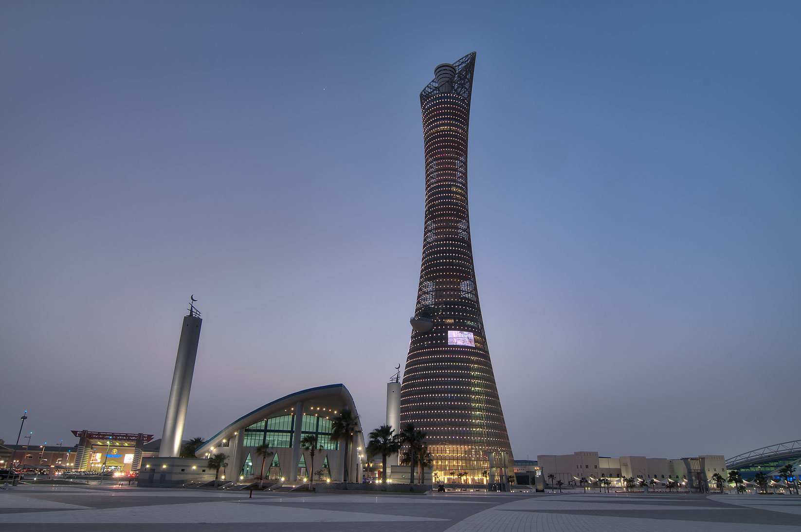 Torch Hotel and Aspire Mosque at evening. Doha, Qatar