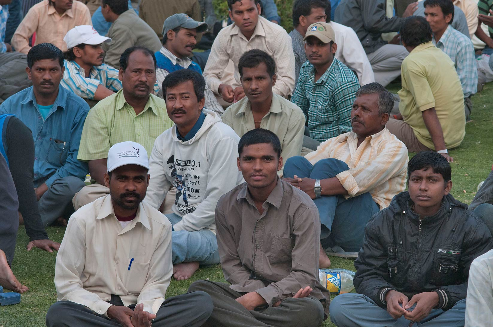 Group of workers meeting near Central Bus Station Al Ghanim on Friday evening. Doha, Qatar