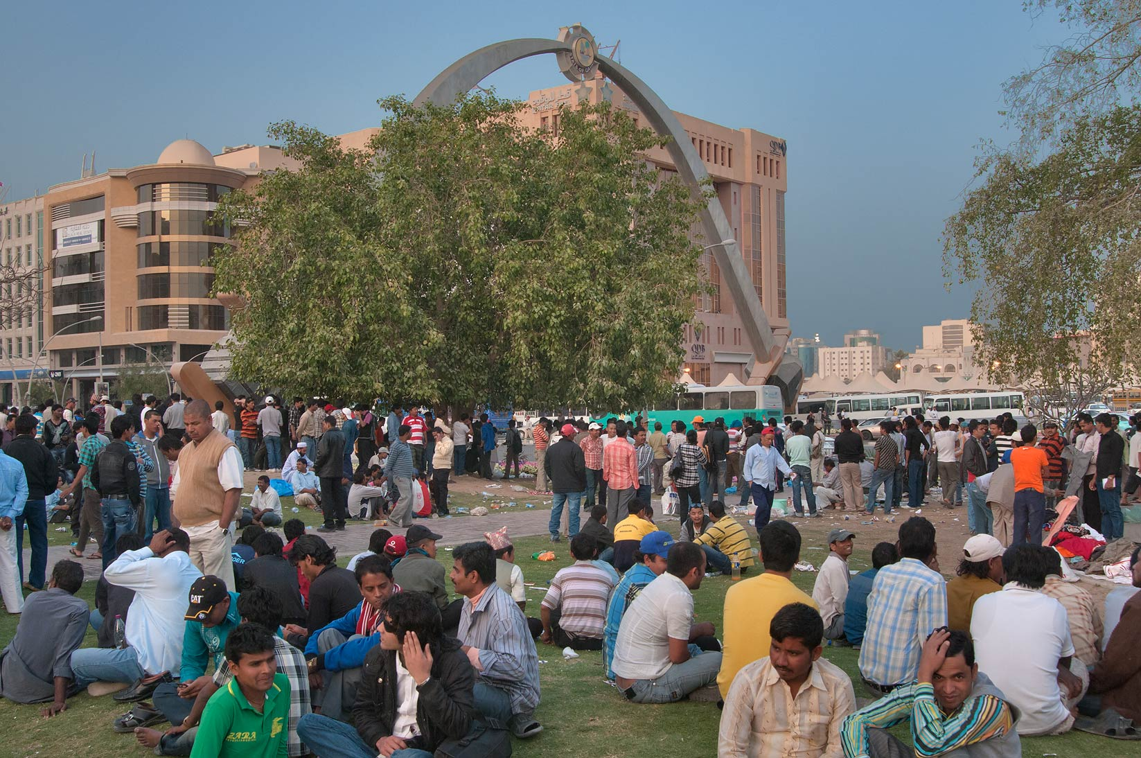 Crowds of migrant workers near Sword Arch at...Station on Friday evening. Doha, Qatar