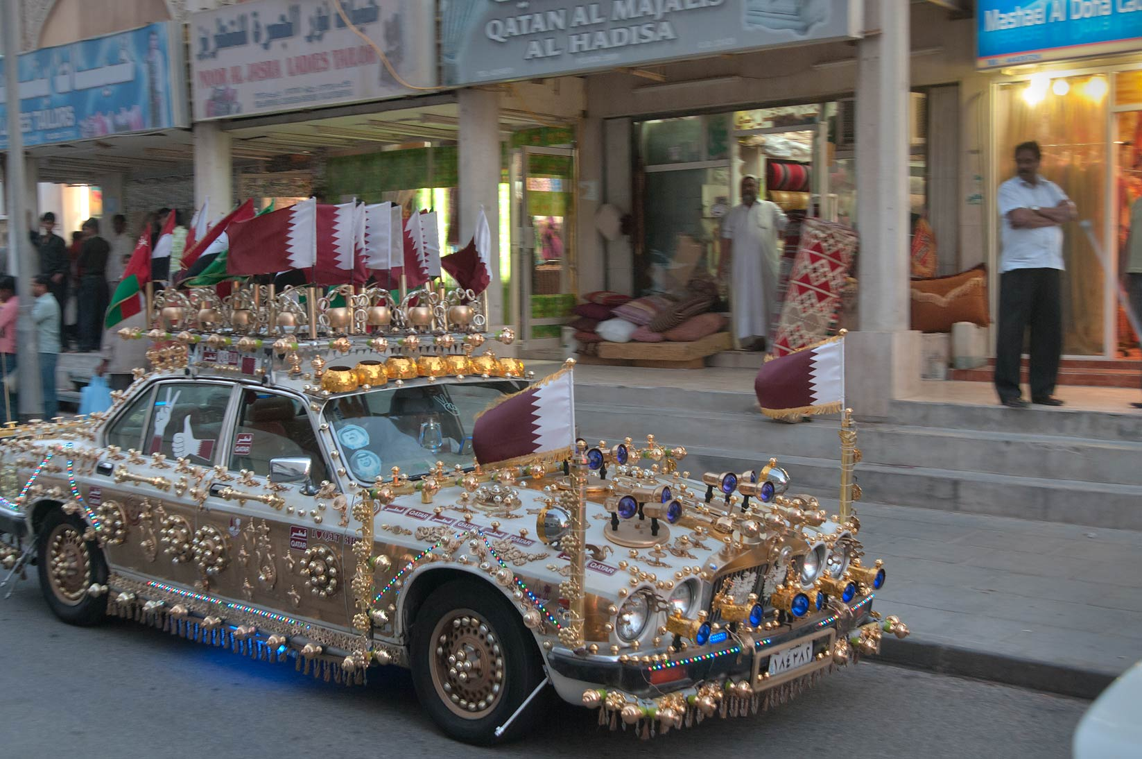 Gaudily decorated car of Ahmed Al Jaber passing...Souq on Friday evening. Doha, Qatar