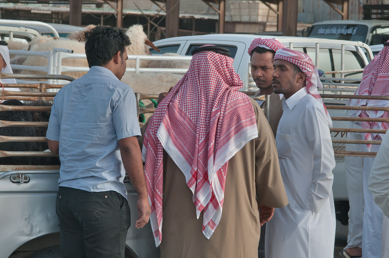 Bargaining near a truck in Sheep Market, Wholesale Market area. Doha, Qatar