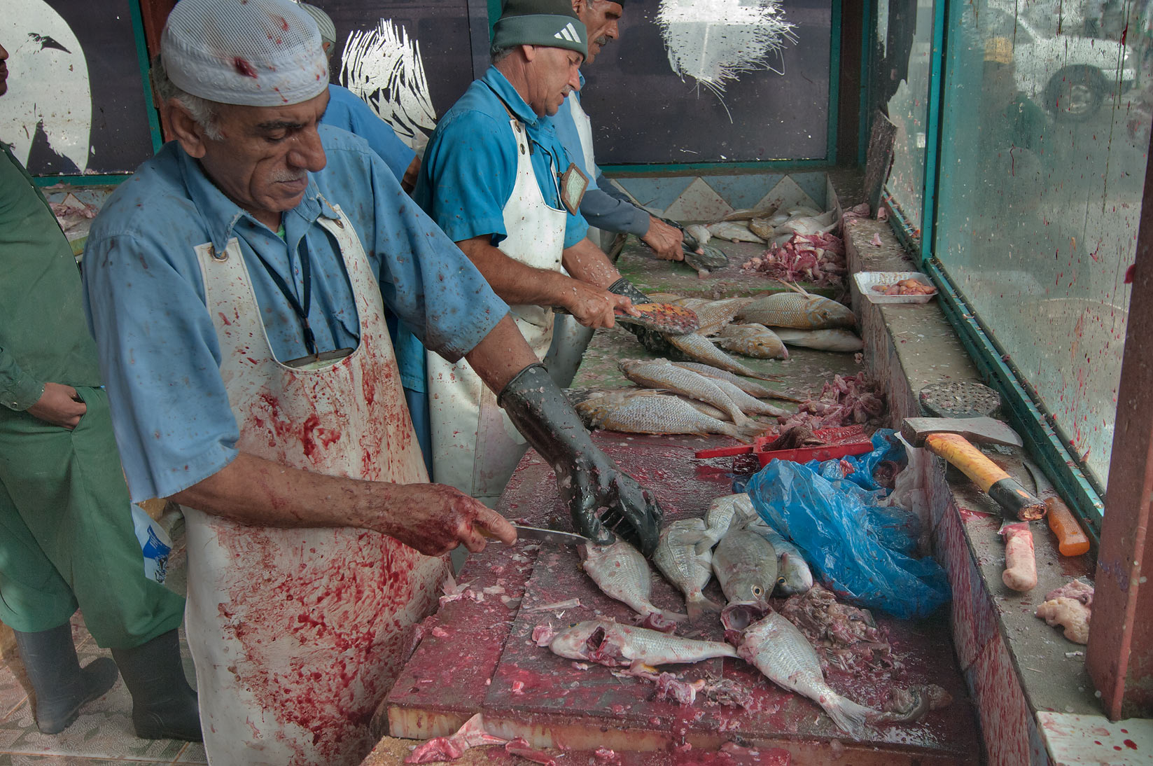 Cleaning fish in Fish Market, Wholesale Markets area. Doha, Qatar