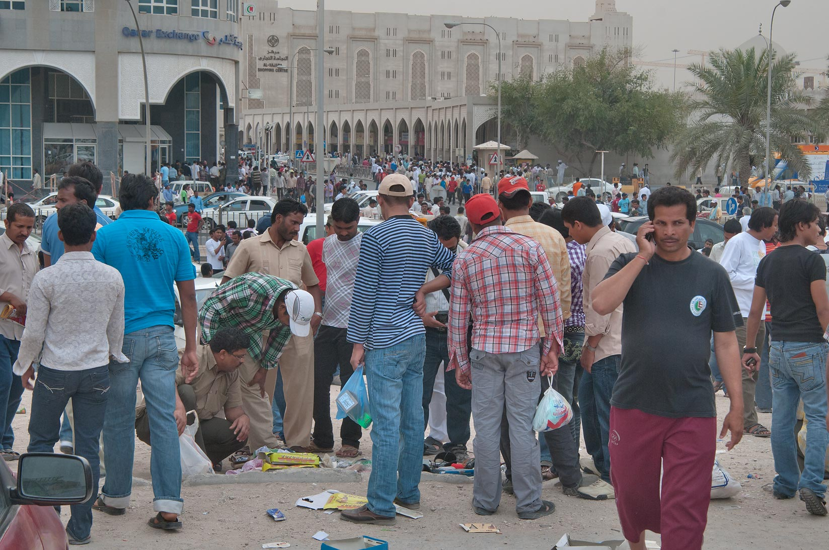 Workers crowding at flea market at Central Bus Station Al Ghanim. Doha, Qatar