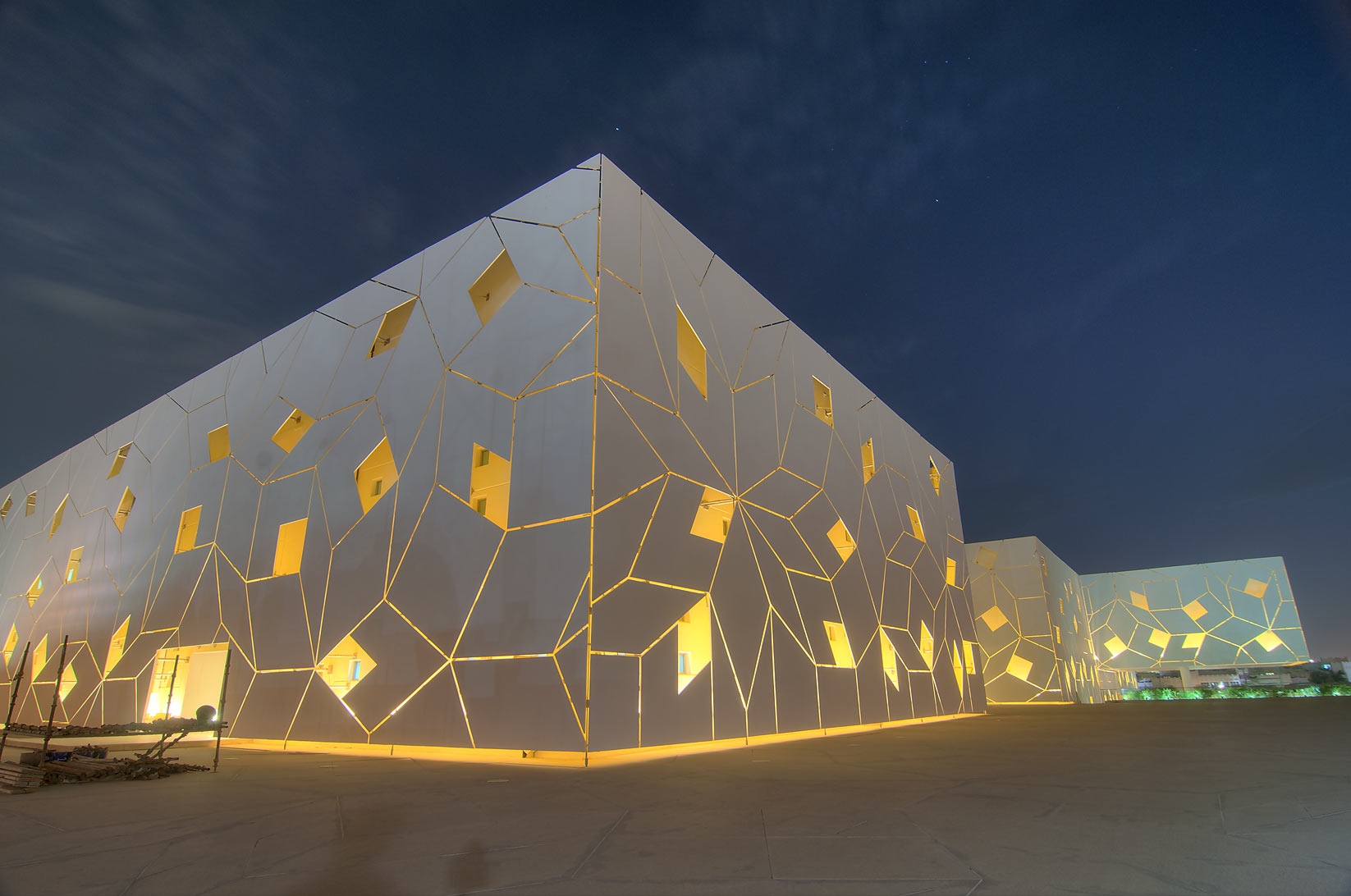 Quasi-crystal pattern of exterior facade of...City campus at evening. Doha, Qatar