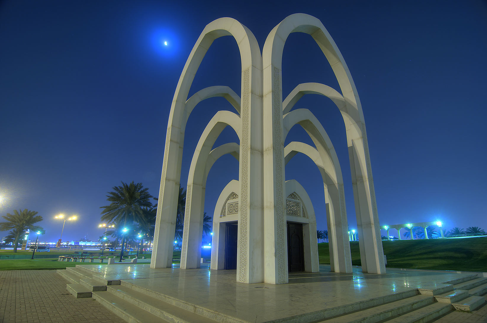 The arch of Rumeilah (Al Bidda) Park at night. Doha, Qatar