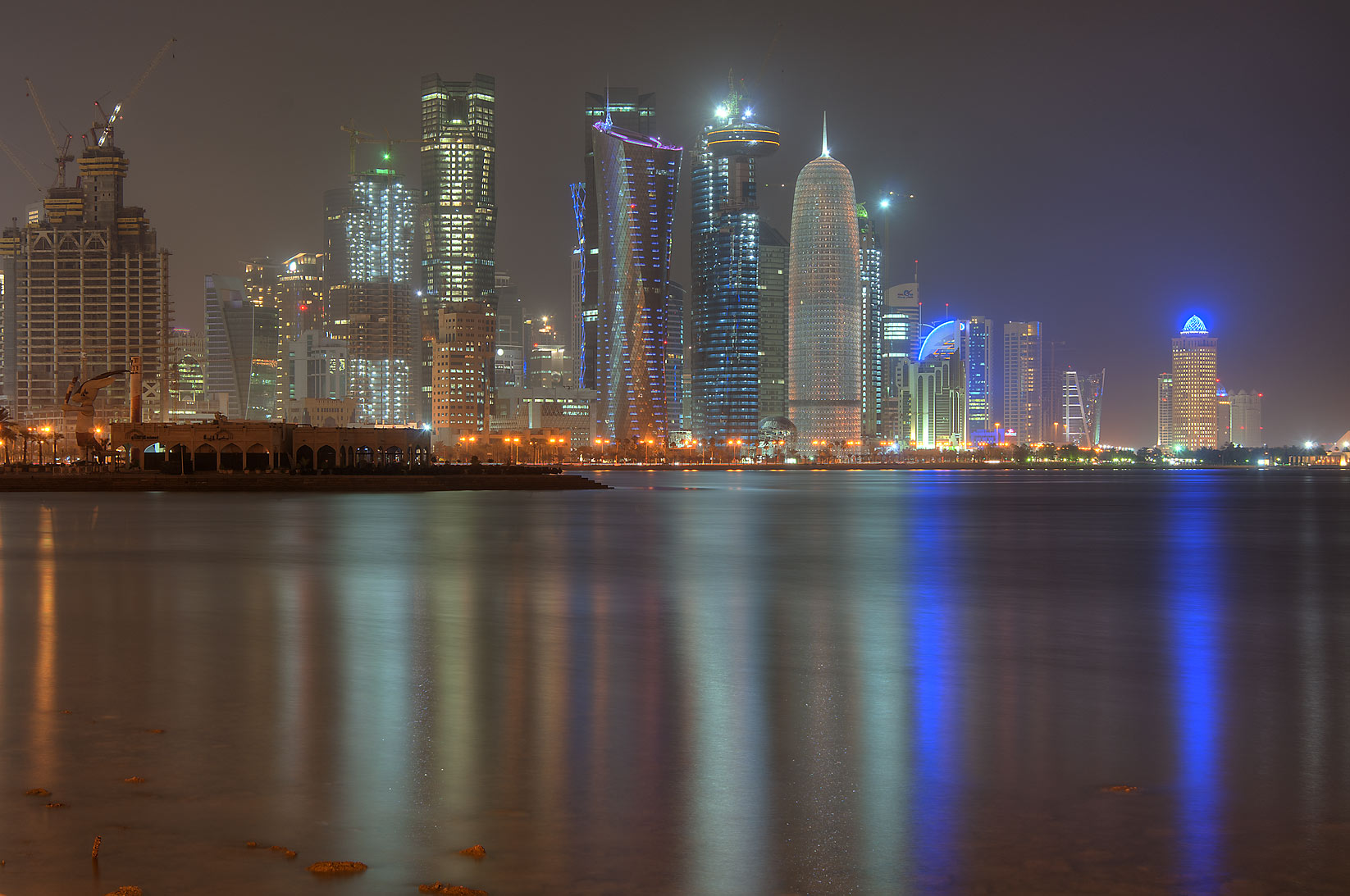 Reflections of West Bay lights from Corniche...to Al Bidda Park at night. Doha, Qatar