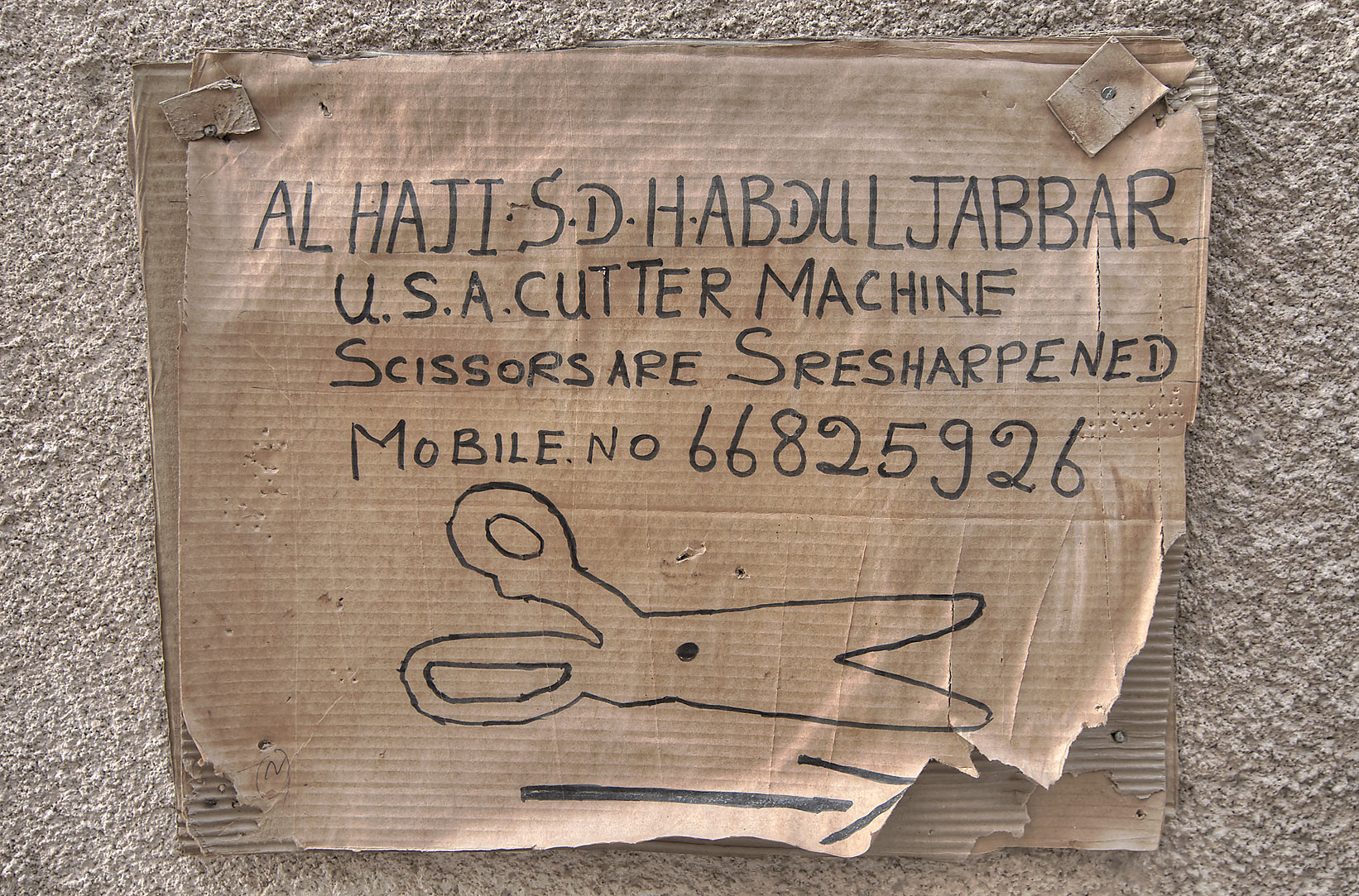 Advertisement of American cutter machine in...St., Musheirib area. Doha, Qatar
