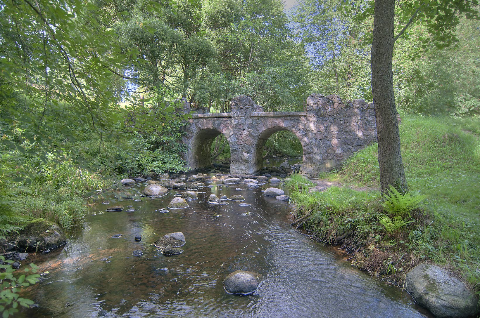 Stone bridge of Karasta River in the park...miles west from St.Petersburg, Russia