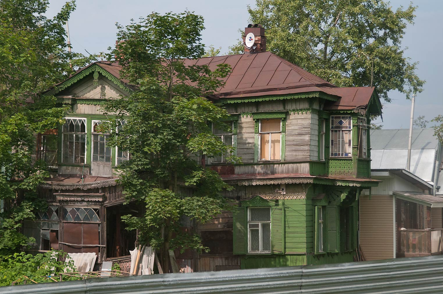 Wooden house in Ozerki, view from a window of a train. St.Petersburg, Russia