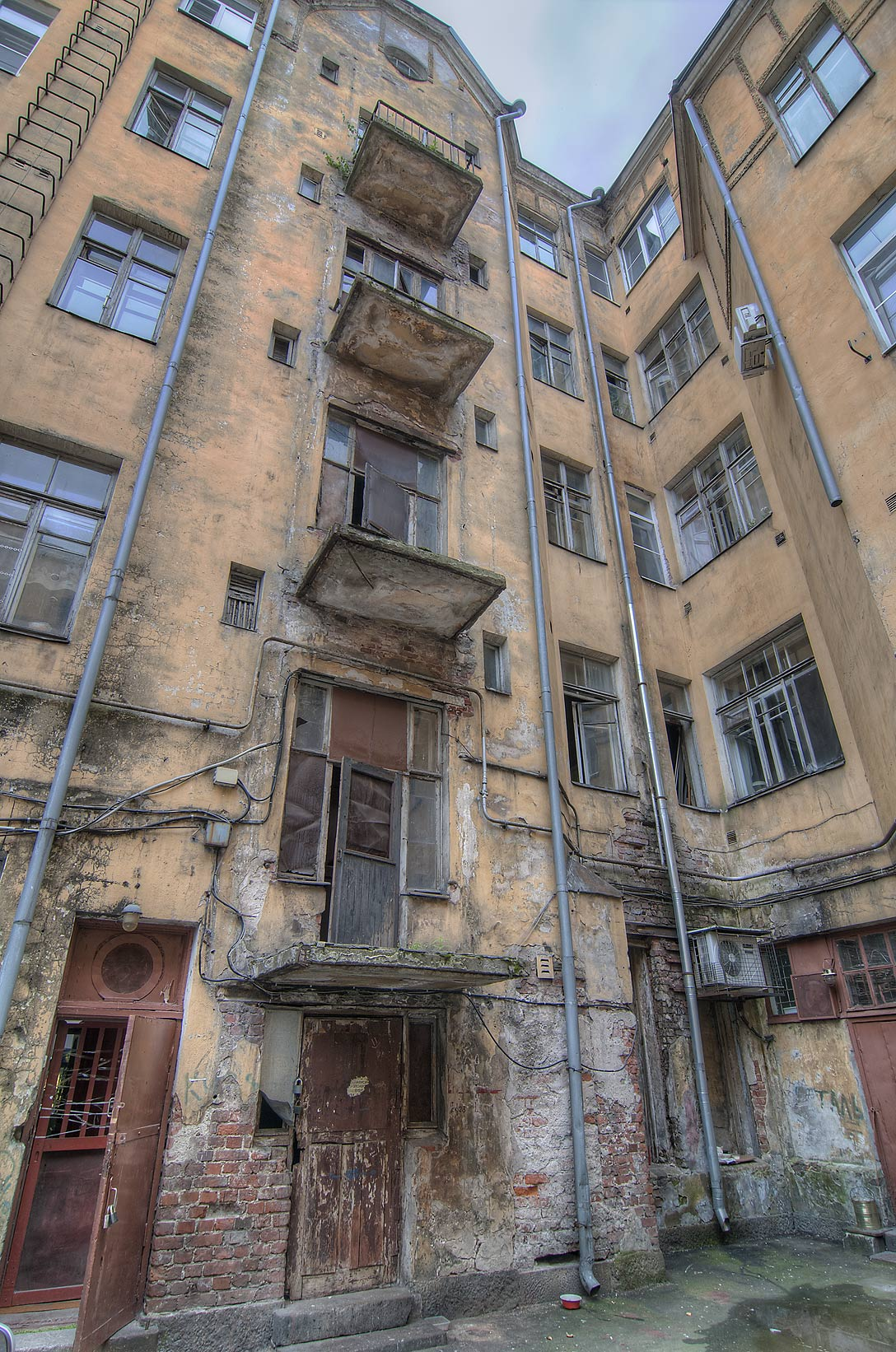Balconies at 6 Lenina St. showing water damage. Vyborg, Russia