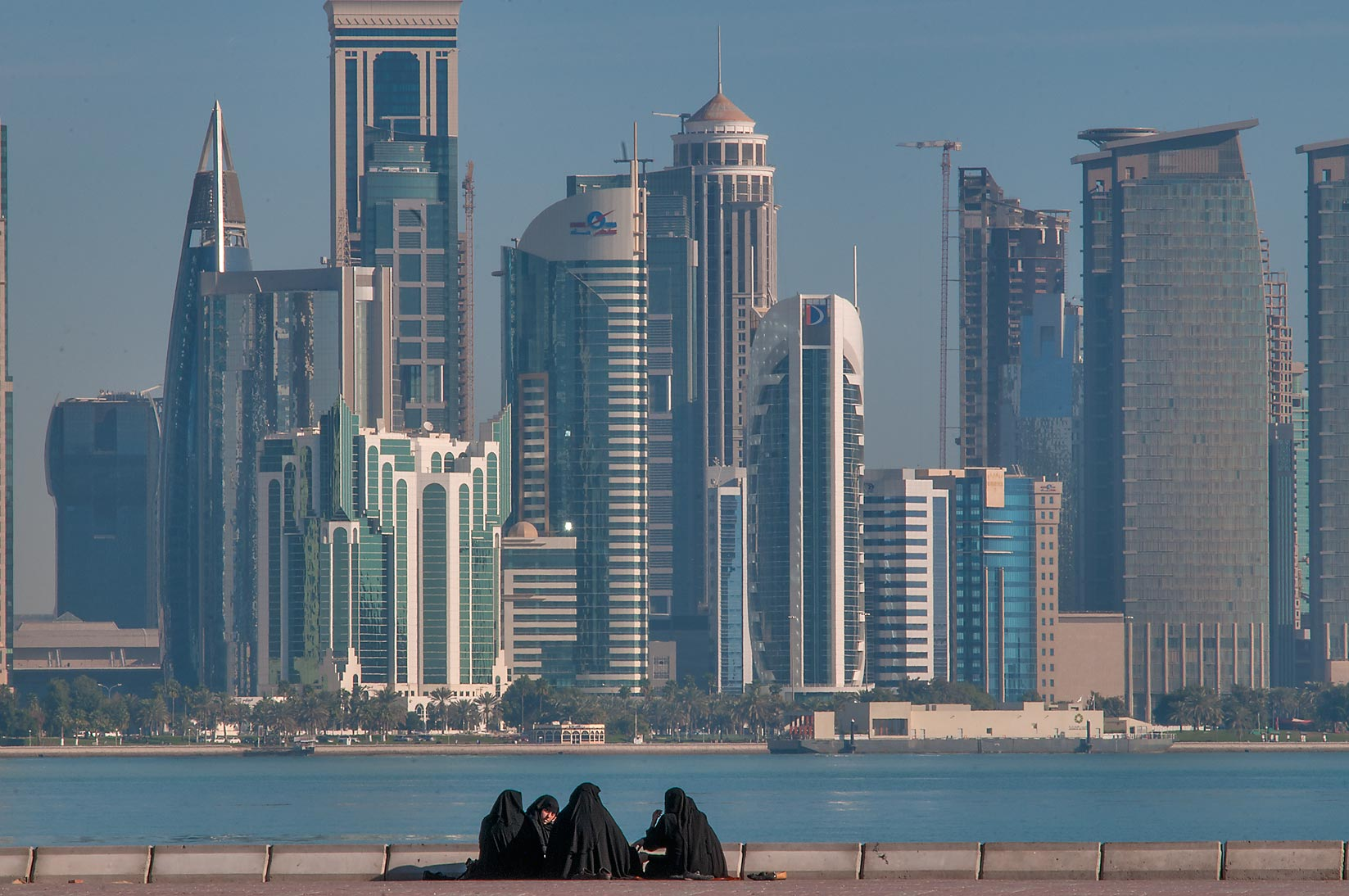 Picnic on Corniche at morning, with West Bay in background. Doha, Qatar