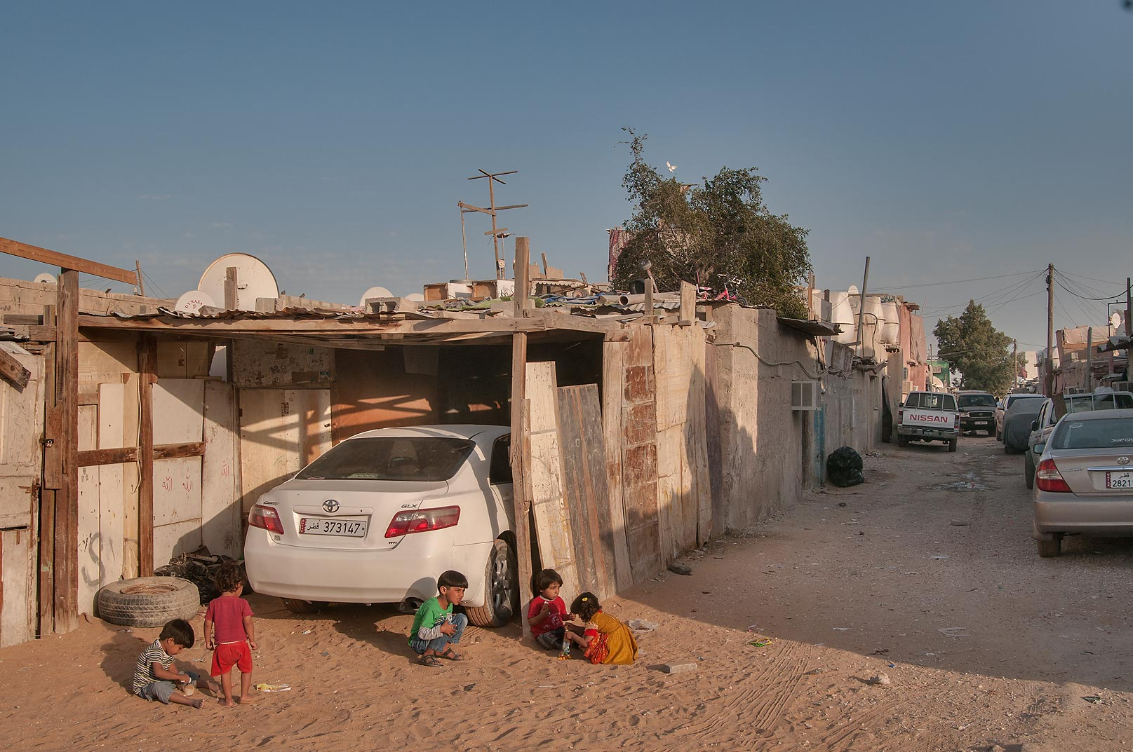 Children playing in Baluchi (Pakistani) Camp in Abu Hamour area. Doha, Qatar