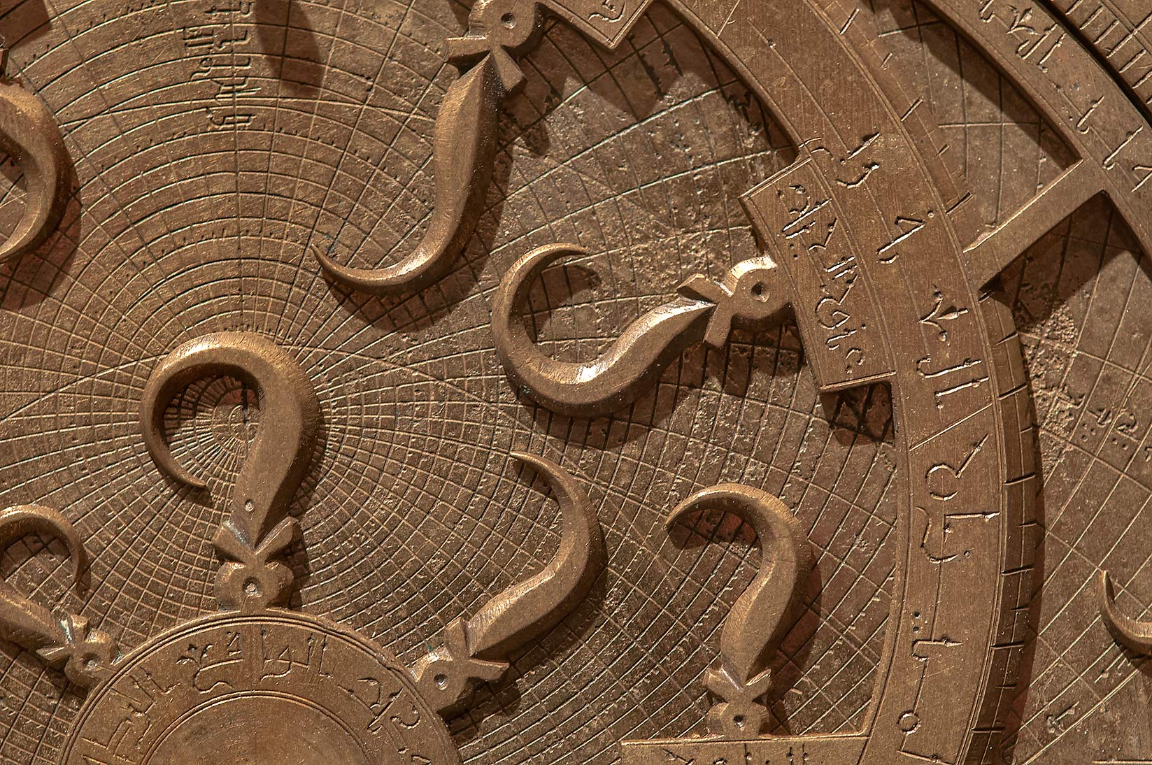 Fragment of brass astrolabe on display in Museum of Islamic Art. Doha, Qatar