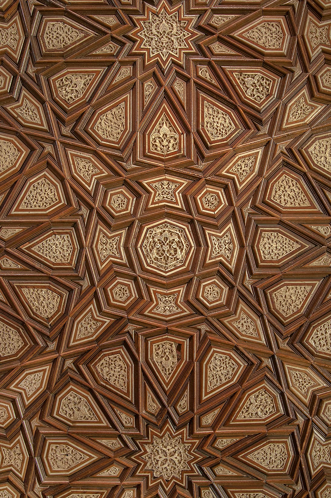 Polygonal pattern on a door in Museum of Islamic Art. Doha, Qatar