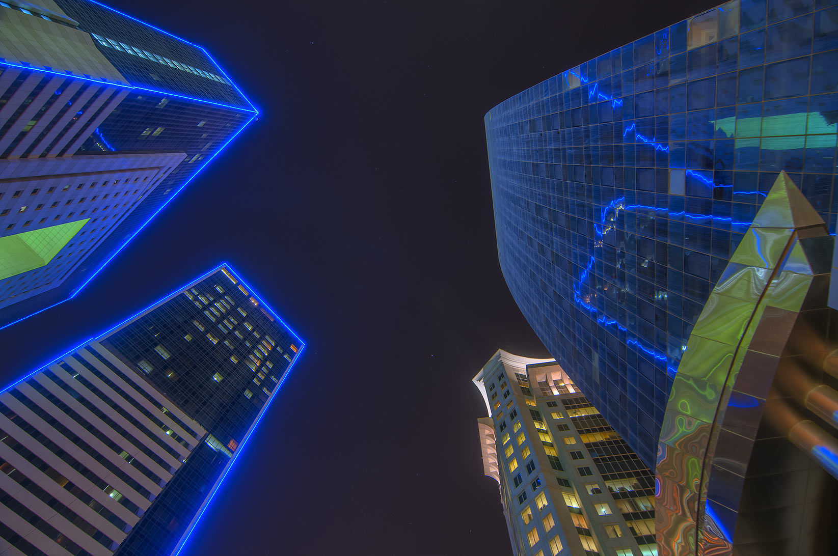Blue lights of Ezdan Hotel in West Bay. Doha, Qatar