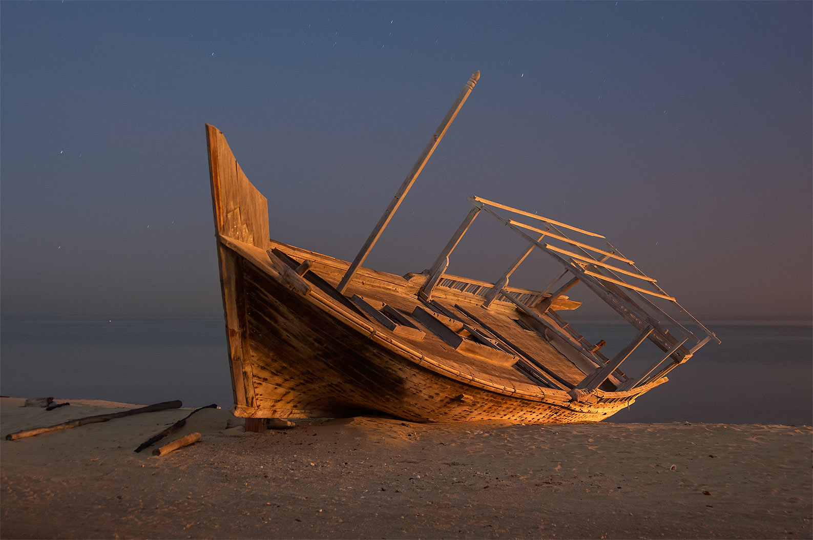 Dhow fishing boat on a beach in Al Wakra at early morning. Qatar