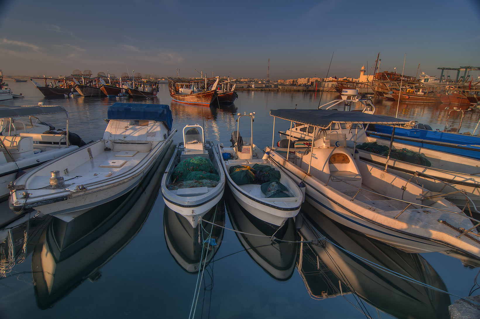 Boats with their reflections in harbor in Al Wakra. Qatar