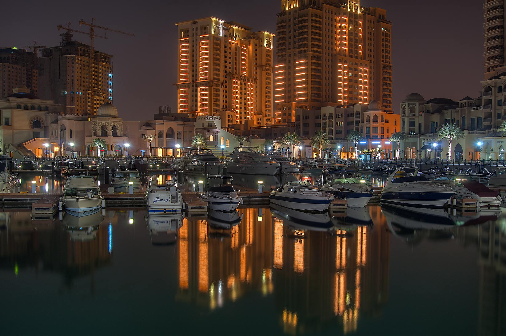 Reflections in marina of Porto Arabia in Pearl Qatar Development. Doha, Qatar