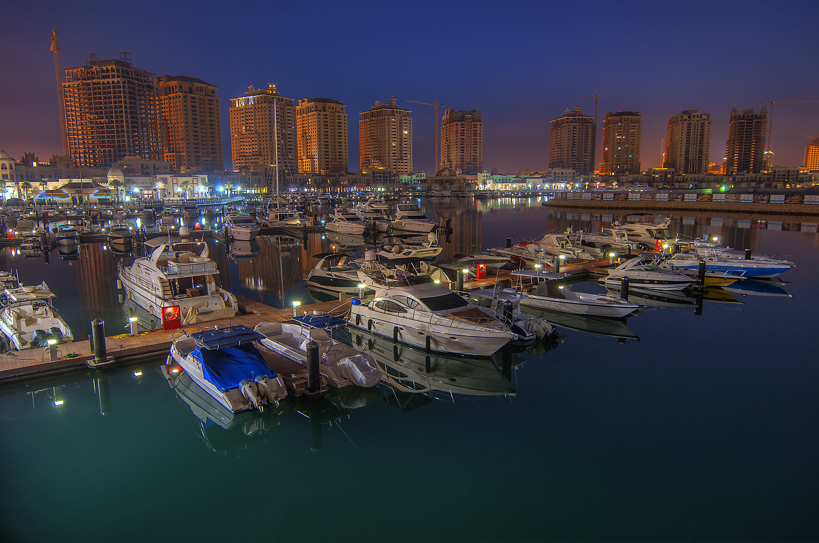 Marina in Porto Arabia in Pearl Qatar Development at morning dusk. Doha, Qatar