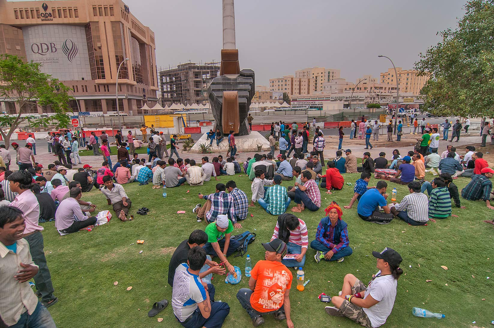 Migrant workers on a lawn at Grand Hamad...Al Ghanim on Friday. Doha, Qatar