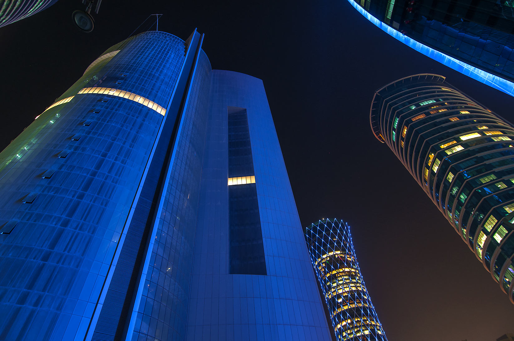 Blue dusty tower in West Bay at evening. Doha, Qatar