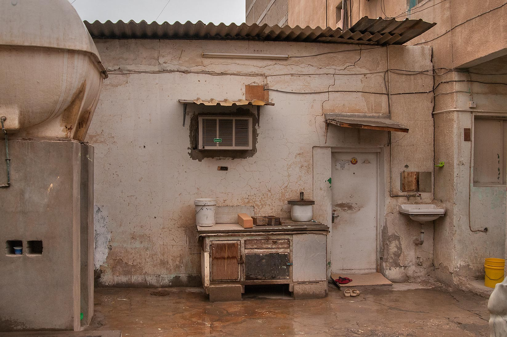 Communal kitchen at Al Jassasiya St., Musheirib area. Doha, Qatar
