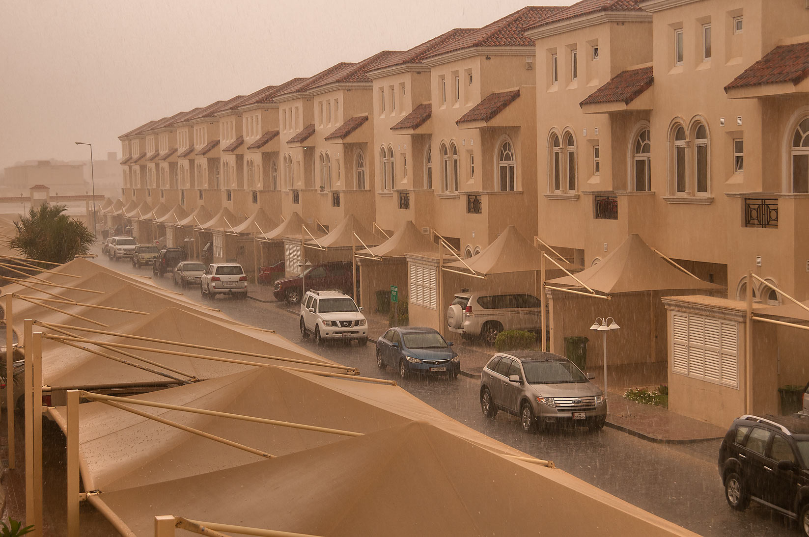 Heavy rain from a balcony of Apartment 7B5 of Dar...Compound, Abu Hamour area. Doha, Qatar