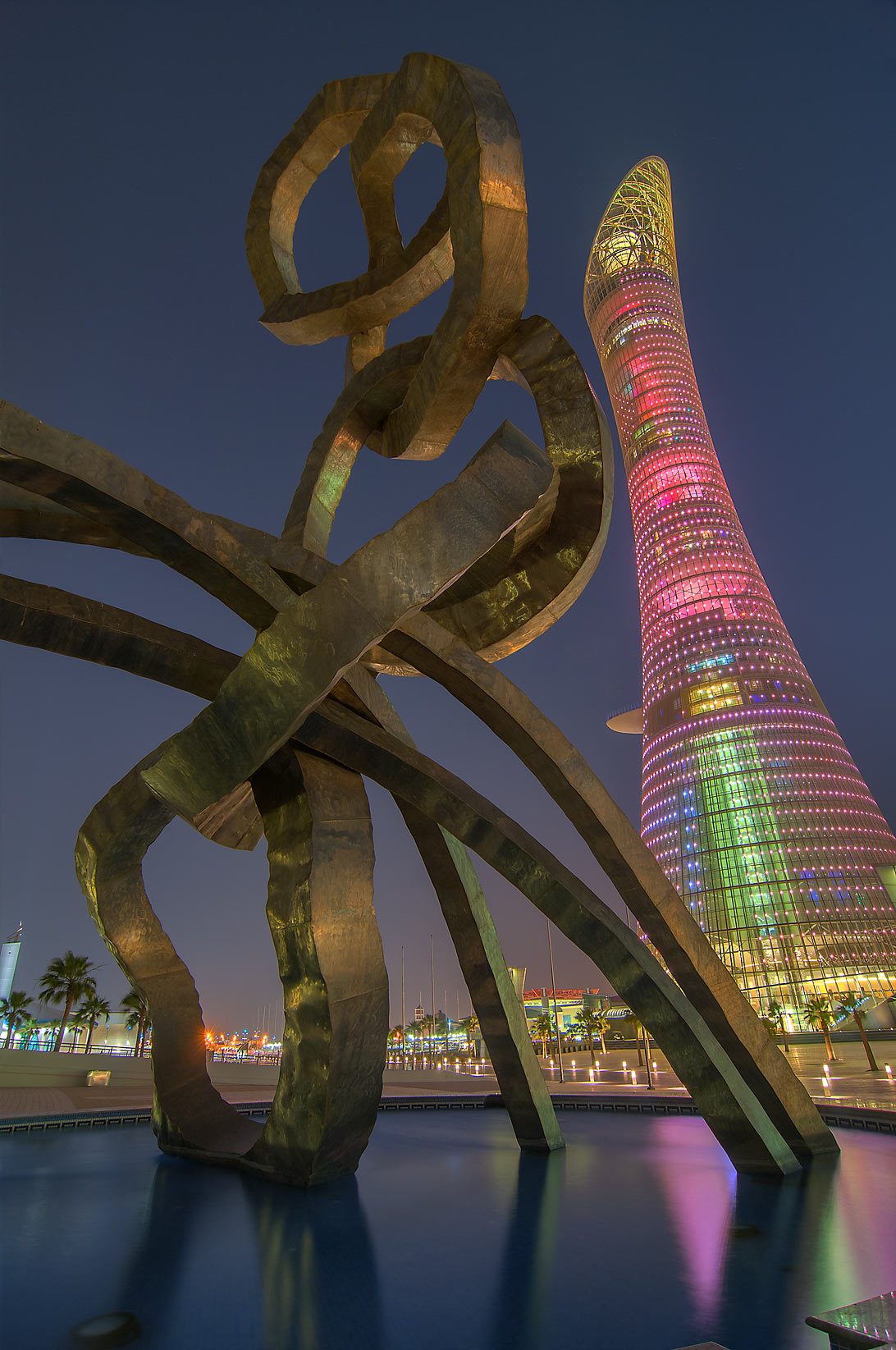 Olympic rings and Torch Tower sculpture in Aspire Zone at evening. Doha, Qatar