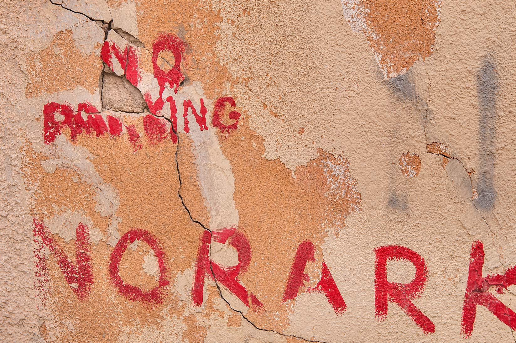 Painted NORARKING sign (graffiti) at Sikkat Bishr...Bakhoor St., Najma area. Doha, Qatar