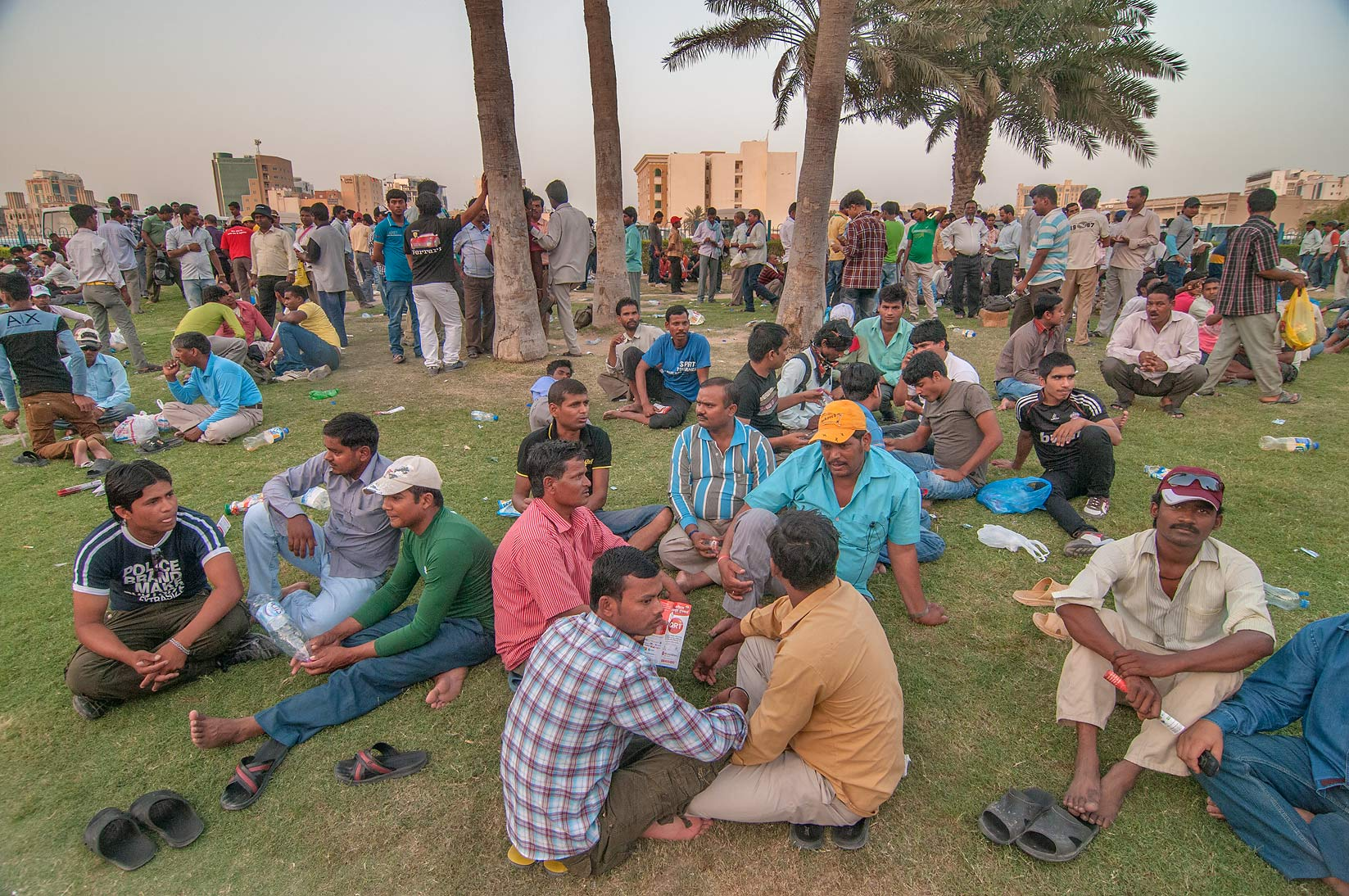 Workers gathering near Central Bus Station Al Ghanim on Friday evening. Doha, Qatar