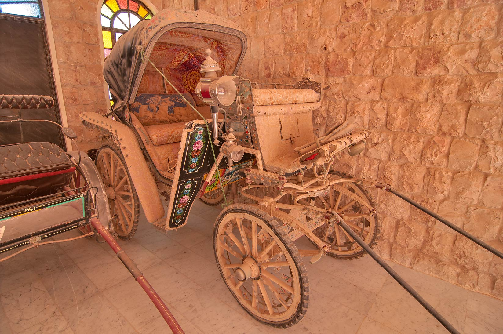 Dusty antique carriage in Sheikh Faisal Bin...Museum near Al-Shahaniya. Doha, Qatar