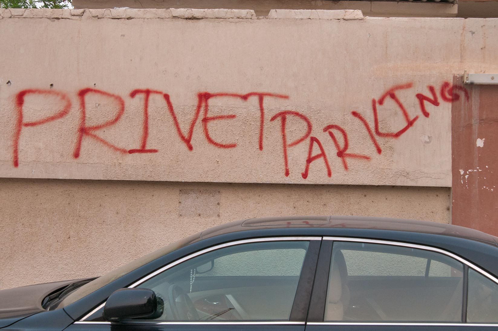 "PRIVET PARKING"" graffiti on Al Diwan St.. Doha, Qatar"