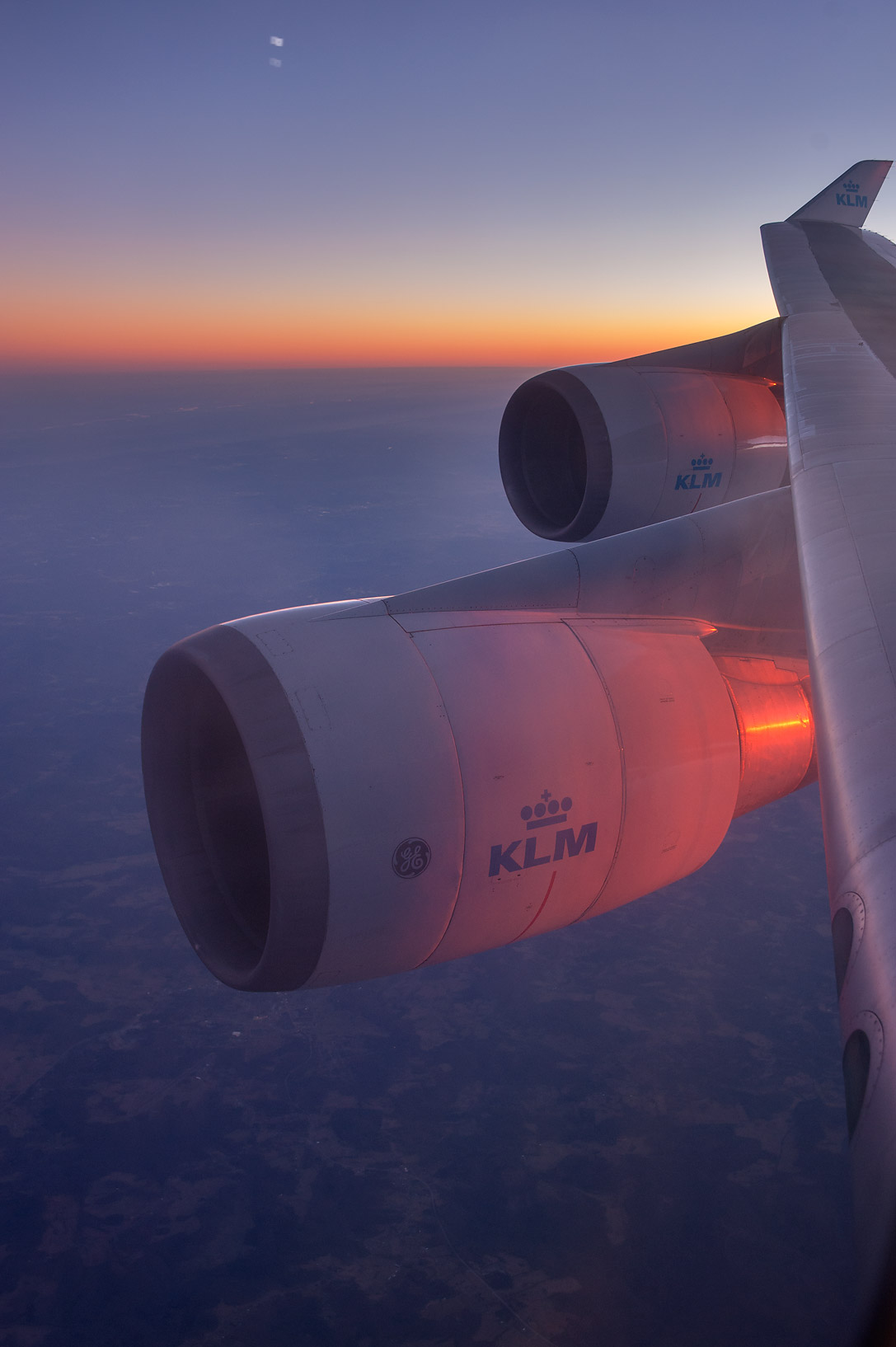Sunset from a window of a plane from Houston, Texas to Europe