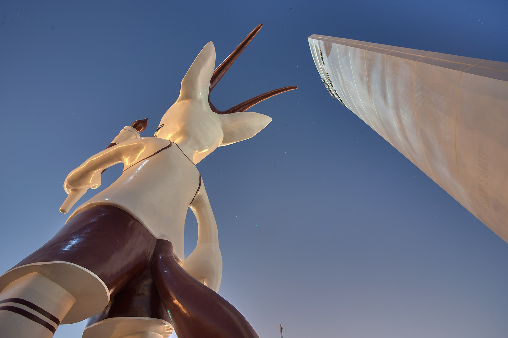 Obelisk and Orry the Oryx (mascot of the 15th Asian Games) statue on Corniche. Doha, Qatar