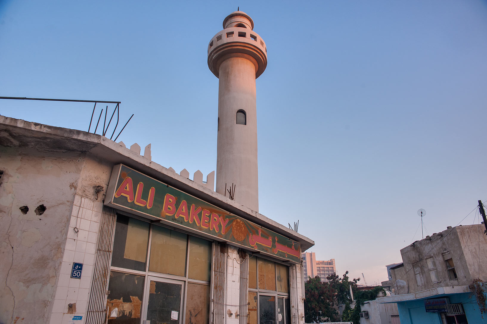 Ali Bakery and a mosque in Musheirib neighborhood area. Doha, Qatar